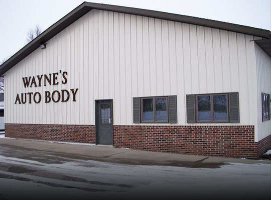 Front entrance of Wayne's Auto Body shop in Le Center, MN